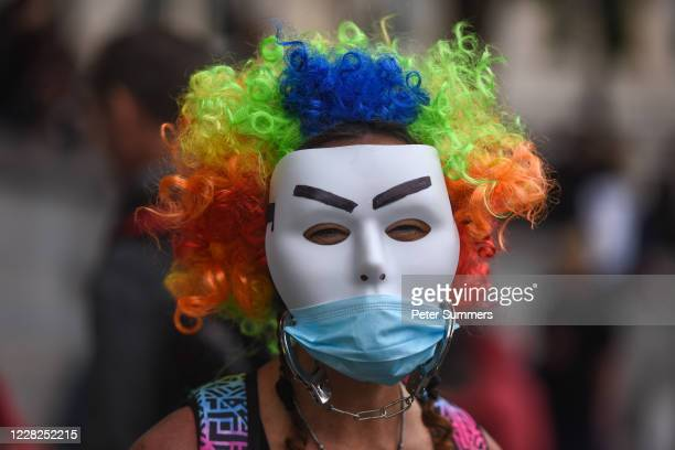 Woman wearing two masks is seen at the Unite for Freedom protest in Trafalgar Sq on August 29, 2020 in London, England. Speakers, including Jeremy...