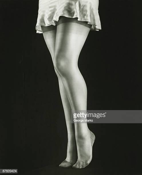woman wearing underskirt and stockings, (b&w), low section - stockings no shoes stock photos and pictures