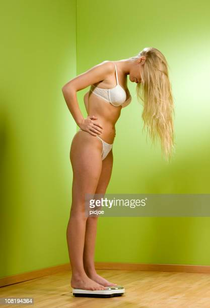 Woman Wearing Underwear and Checking Weight