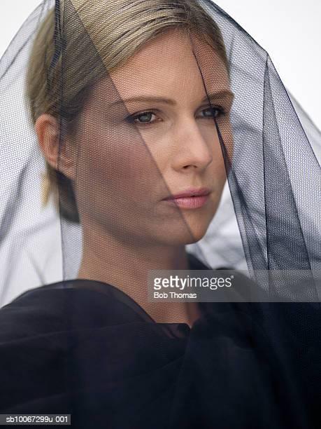 Woman wearing veil, close-up