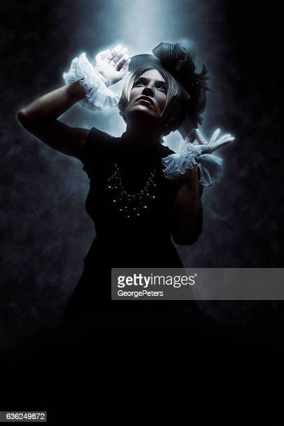Woman Wearing Vintage Clothes with Dramatic Lighting