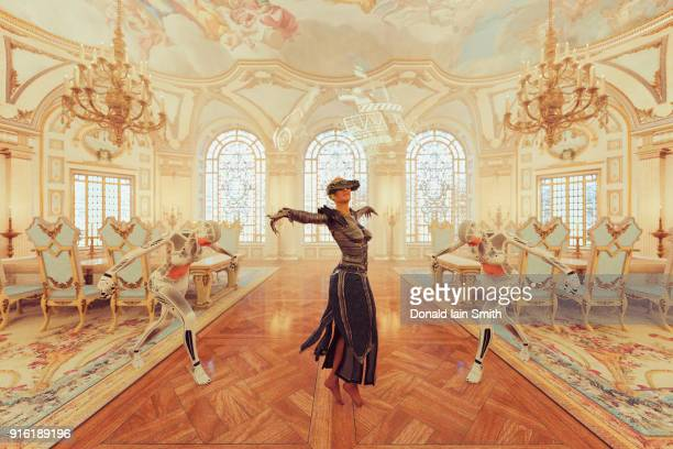 woman wearing virtual reality goggles dancing in ballroom - balzaal stockfoto's en -beelden