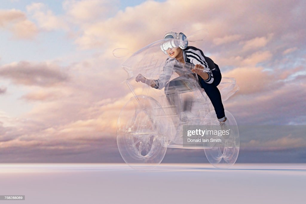 Woman wearing virtual reality helmet riding motorcycle