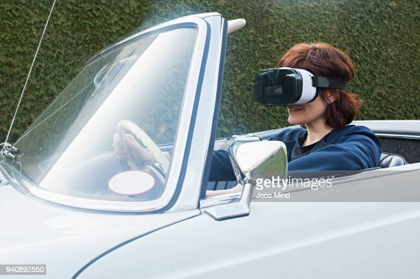 woman wearing vr glasses, driving convertible