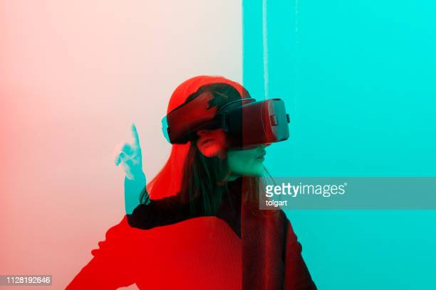 woman wearing vr glasses - innovation stock pictures, royalty-free photos & images