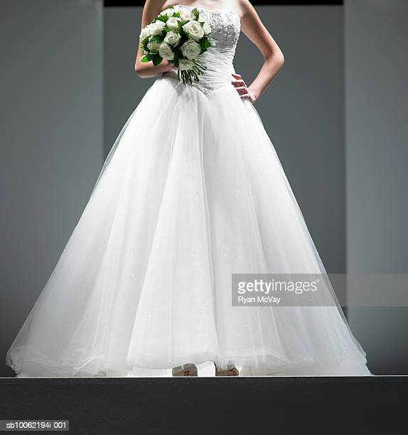 Woman wearing wedding dress on stage
