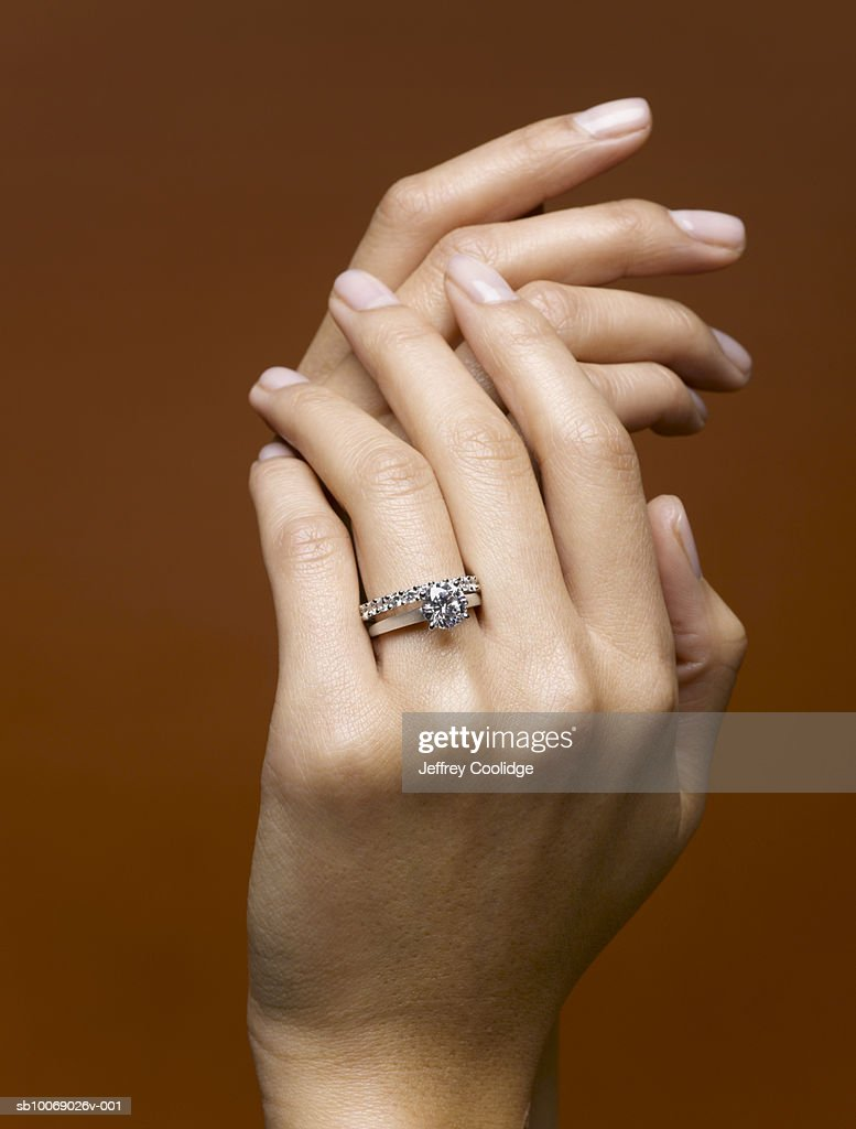 Woman Wearing Wedding Rings Closeup Of Hands Stock Photo Getty Images