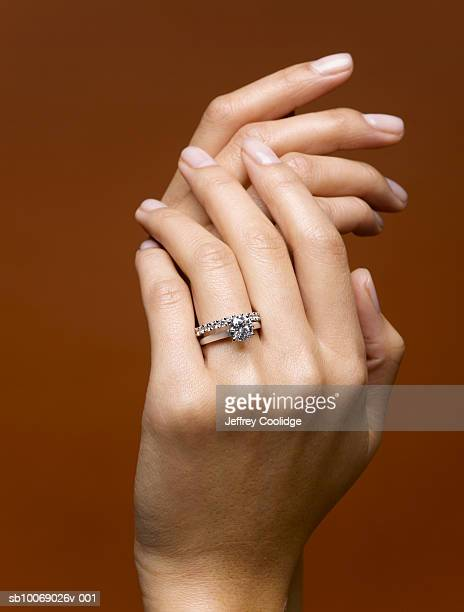 Woman wearing wedding rings, close-up of hands