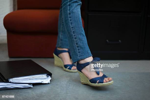 Woman wearing wedge espadrilles, low section
