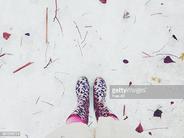 Woman wearing wellington boots standing on snow