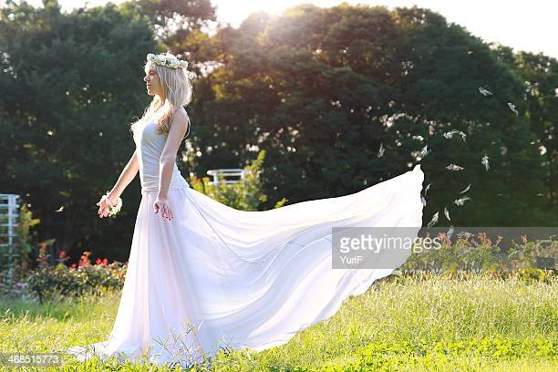 woman wearing white dress. - wedding dress stock pictures, royalty-free photos & images