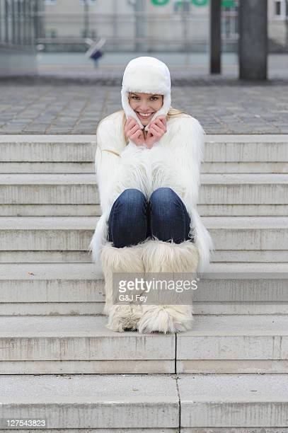 woman wearing winter clothes on steps - hairy women stock pictures, royalty-free photos & images