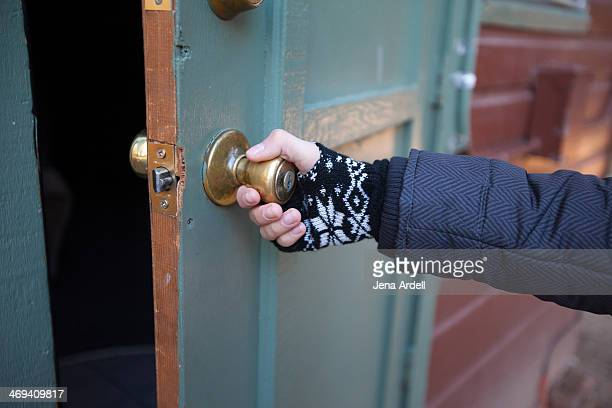 woman wearing winter gloves opening cabin door - 指なし手袋 ストックフォトと画像