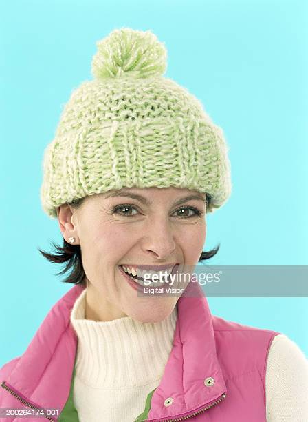 Woman wearing wollen hat, smiling, portrait, close-up