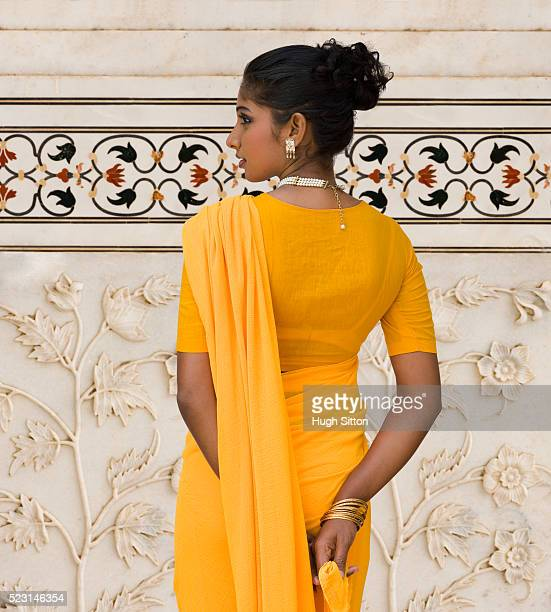 woman wearing yellow sari - hugh sitton stock pictures, royalty-free photos & images