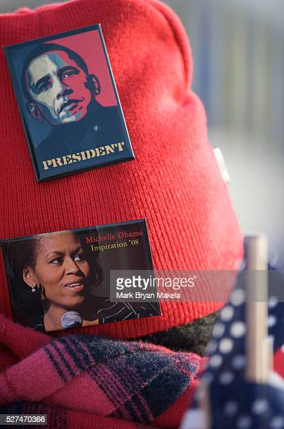 A woman wears a Barack and Michele Obama commemorative pins during Obama's historic Presidential inauguration An estimated two million people flocked...