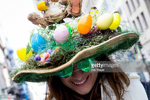 A woman wears a bonnet during the Easter Parade and Bonnet Festival along 5th Avenue March 27 2016 in New York City The parade is a New York...
