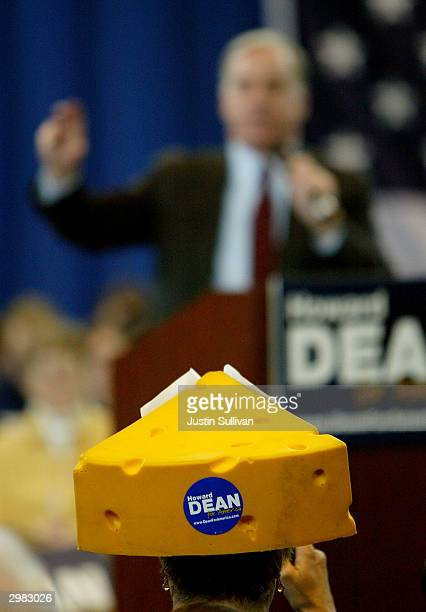 A woman wears a cheesehead hat as democratic presidential hopeful Howard Dean speaks to supporters at the Racine on the Lake Civic Center February 14...