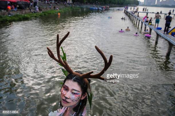 A woman wears a costume at East Lake on August 19 2017 in Wuhan Hubei province China This activity which requires participants to ride their bikes...