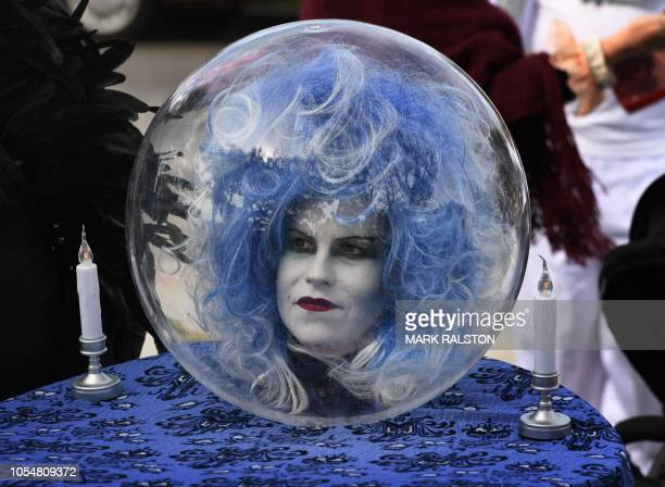 A woman wears a costume at the annual Haute Dog Howl'oween parade in Long Beach California on October 28 2018