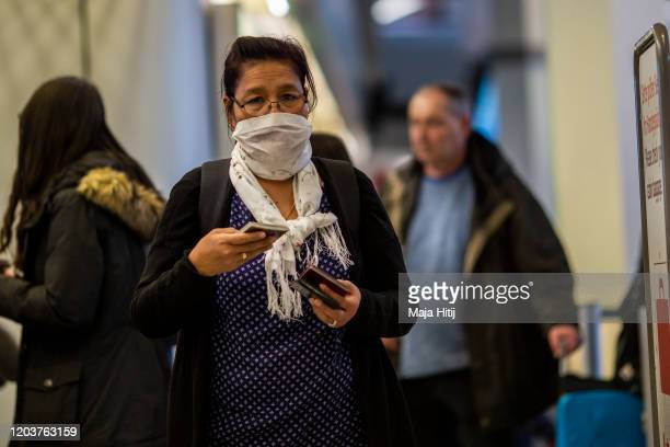 A woman wears a face mask at Airport Tegel on February 03 2020 in Berlin Germany As more cases of coronavirus are being confirmed across the globe...