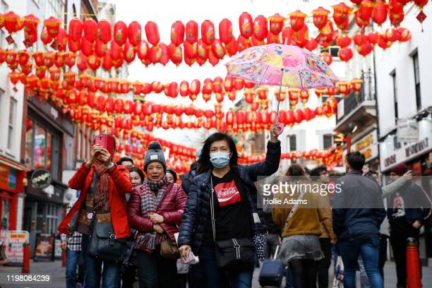A woman wears a face mask in Chinatown on February 2 2020 in London England There are currently 2 confirmed cases of Coronavirus in the UK