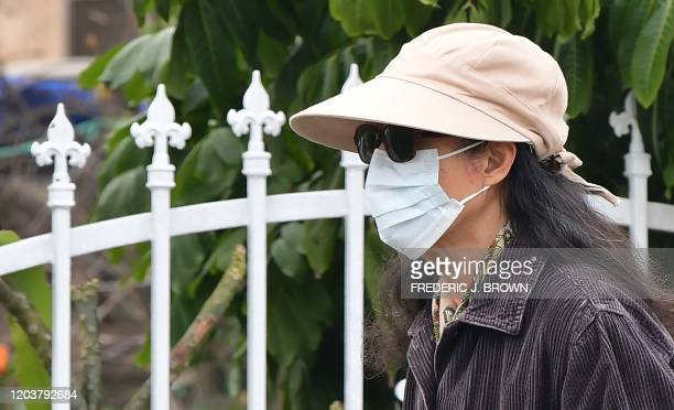 A woman wears a face mask in Monterey Park California on February 27 2020 Health and emergencymanagement officials said on February 27 to a Los...