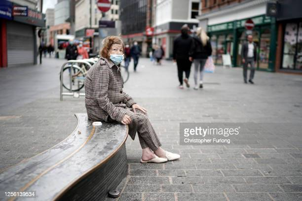 A woman wears a face mask on the high street on July 14 2020 in Liverpool United Kingdom The UK government has announced that people entering shops...