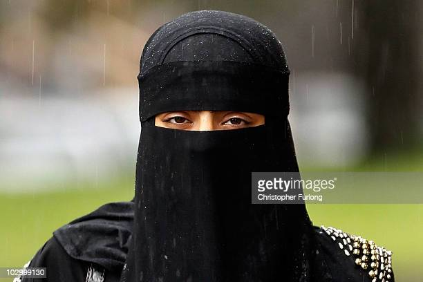 Woman wears a full face Niqab on the streets July 20, 2010 in Blackburn, England. Syria has banned the wearing of full face veils in its...
