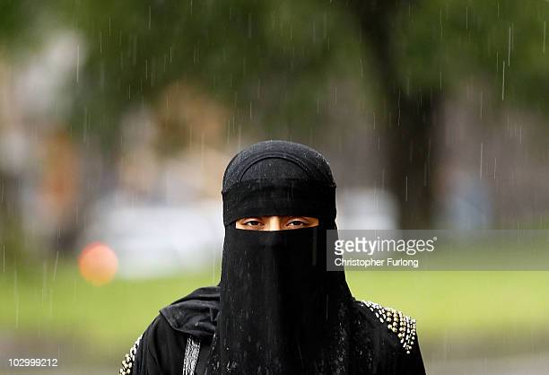 A woman wears a full face Niqab on the streets July 20 2010 in Blackburn England Syria has banned the wearing of full face veils in its universities...