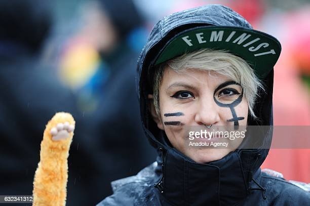 A woman wears a hat and holds a cat paw during the Women's March On Portland in Portland Oregon USA on January 21 2017 Tens of thousands gathered to...