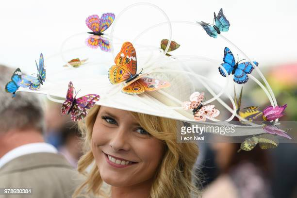 A woman wears a hat decorated with butterflies during day one of Royal Ascot at Ascot Racecourse on June 19 2018 in Ascot United Kingdom Royal Ascot...
