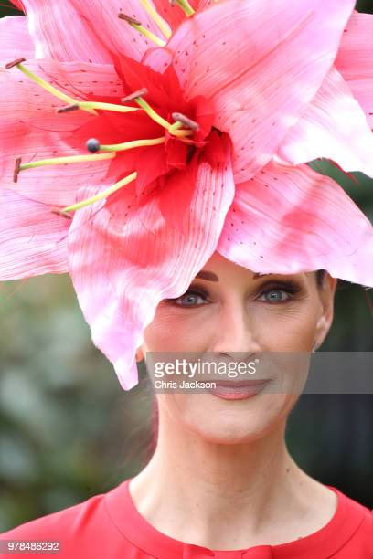 A woman wears a hat in the shape of a pink flower during Royal Ascot Day 1 at Ascot Racecourse on June 19 2018 in Ascot United Kingdom