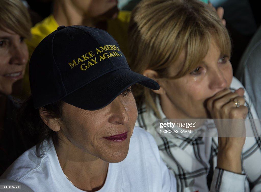 A woman wears a hat reading 'Make America Gay Again' as US President Barack Obama speaks at a campaign event for Democratic presidential candidate Hillary Clinton in Las Vegas on October 23, 2016. / AFP / NICHOLAS