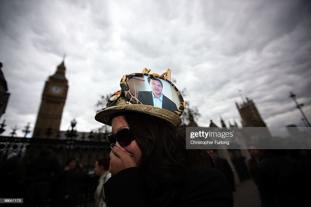 A woman wears a hat with a photograph of Liberal Democrat leader Nick Clegg outside the Houses of Parliament on May 11, 2010 in London, England. Gordon Brown has resigned his position and David Cameron has become the new British Prime Minister.