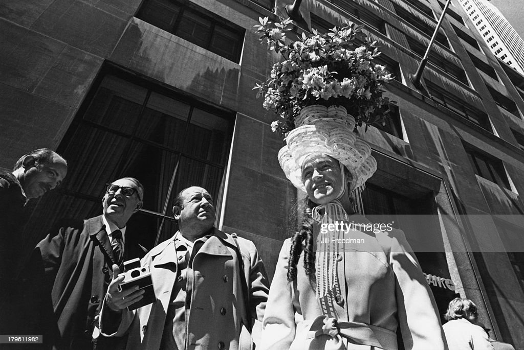 A woman wears a large Easter bonnet on 5th Avenue, New York City, 1977.