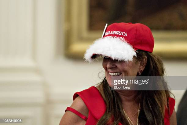 A woman wears a Make America Great Again hat while attending the Congressional Medal of Honor Society reception in the East Room of the White House...