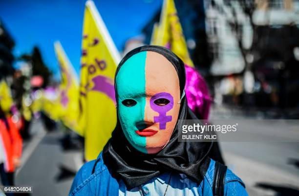 TOPSHOT A woman wears a mask as she takes part in a march on March 5 2017 at Bakirkoy district in Istanbul ahead of the World women day of March 8...