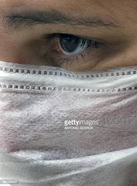 STORY A woman wears a mask as she waits to receive medical attention in Rio de Janeiro on July 23 2009 Authorities said the number of deaths of...