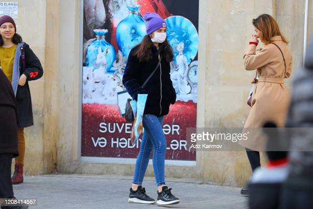 A woman wears a mask in center of Baku on February 24 2020 in Baku Azerbaijan Due to the situation in Iran due to the coronavirus Azerbaijan has...