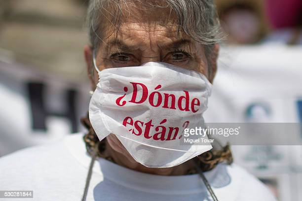 A woman wears a mask that reads '¿Donde están' during a march on Mother's Day on May 08 2016 in Mexico City Mexico Mothers and other relatives of...