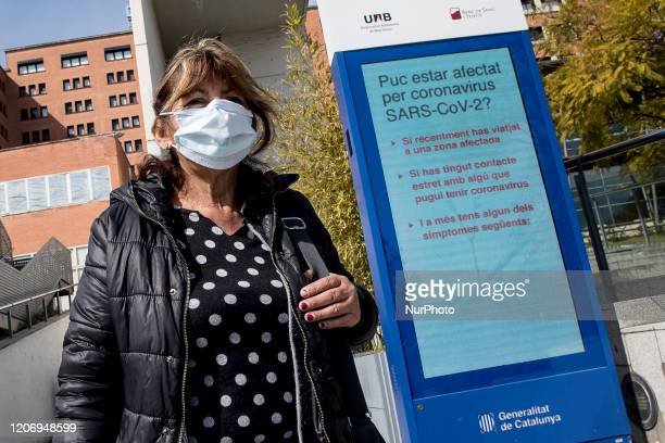 A woman wears a medical mask in front of Vall d'Hebron Hospital during the COVID19 crisis in Barcelona Catalonia Spain on March 12 2020
