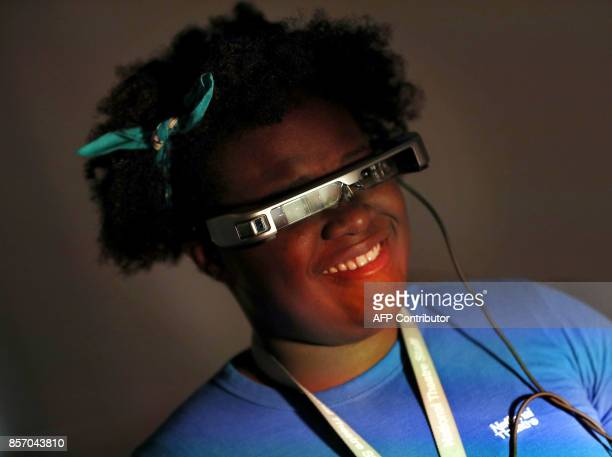 A woman wears a pair of smart glasses using 'Open Access Smart Capture technology' which enables hearing impaired theatregoers to see subtitles in...