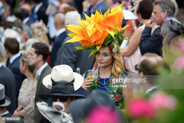 A woman wears a particularly large floral hat during day one of Royal Ascot at Ascot Racecourse on June 19 2018 in Ascot United Kingdom Royal Ascot...