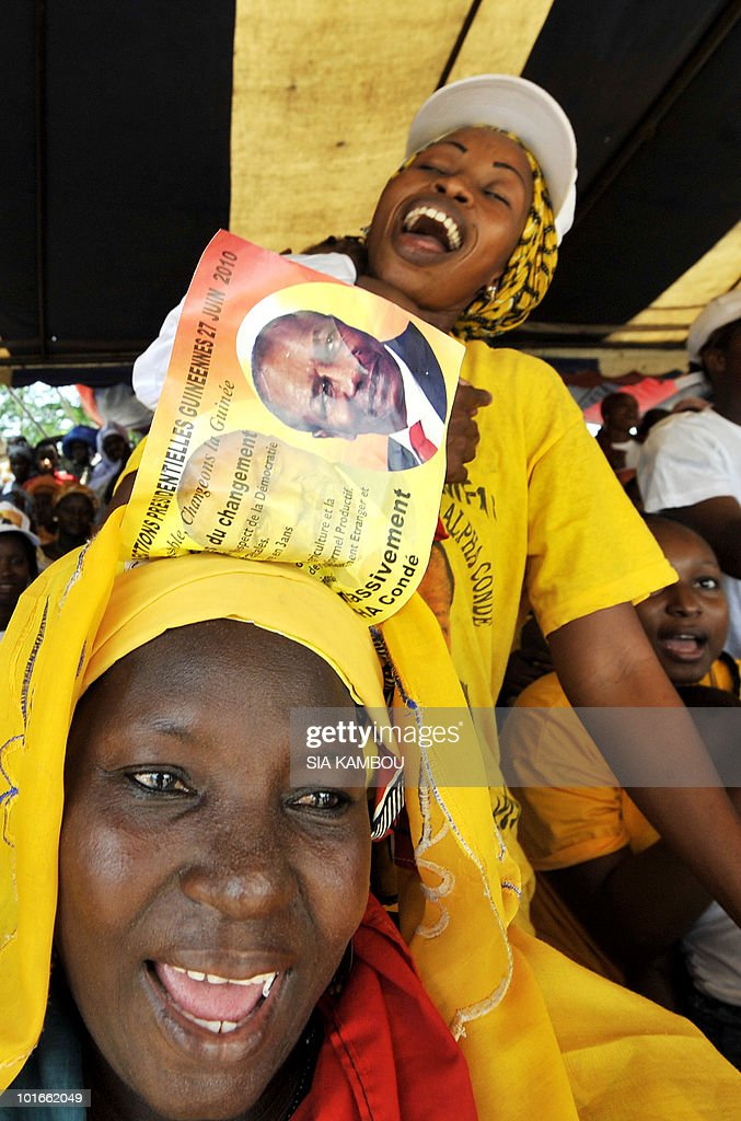 A woman wears a poster with Guinean opposition leader Alpha Conde, who heads the ' Rassemblement du peuple de Guinee' (RPG) political party, in Koumassi, a popular area of Abidjan on June 6, 2010, during a political gathering of Guineans living in Ivory coast to show their support to Mr Alpha Conde ahead of the Guinean presidential election on June, 27, 2010.