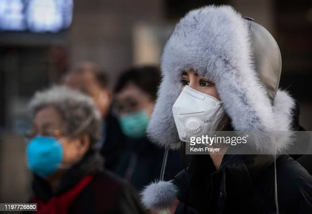 A woman wears a protective mask after getting off a train on January 31 2020 in Beijing China The number of cases of a deadly new coronavirus rose to...