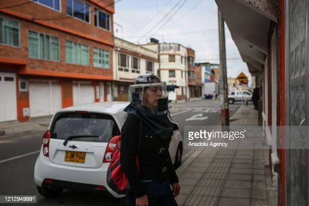 A woman wears a protective mask called Mascaras de vida in Spanish made by the small factory IMPREMPAQ in the municipality of Soacha near to Bogota...