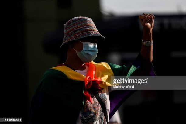 Woman wears a rainbow flag as members of an LGBT group protest against the early release of US soldier Joseph Scott Pemberton at the Boy Scout Circle...