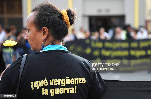 A woman wears a shirt reading 'War is shameful' during a protest against the killing of Ana Fabricia Cordoba Cabrera on June 8 in Medellin Antioquia...