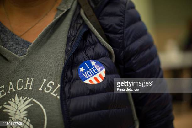 A woman wears a sticker after she cast her vote at a polling station on November 5 2019 in Jersey City New Jersey Voters will decide on a ballot...